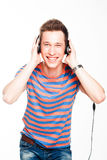 Man listens to music on headphones Stock Images