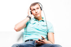 Man listens to music on headphones Stock Photos