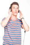 Man listens to music on headphones Stock Photo