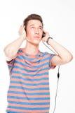 Man listens to music on headphones Royalty Free Stock Photo