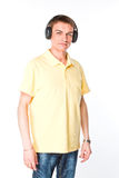 Man listens to music on headphones Stock Photos