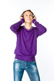 Man listens to music on headphones Royalty Free Stock Photo