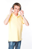 Man listens to music on headphones Stock Photo