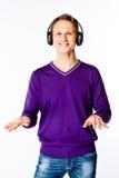 Man listens to music on headphones Stock Image