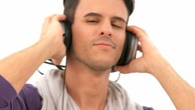 Man listens to music stock video