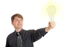 Man lit by bright idea in form of electric light Royalty Free Stock Image