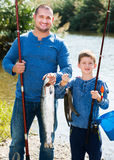 Man and little boy fishing Royalty Free Stock Image