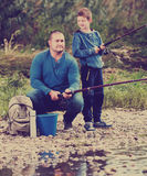 Man and little boy fishing Royalty Free Stock Photography