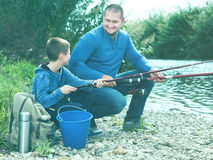 Man and little boy fishing Royalty Free Stock Images