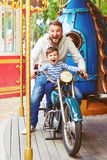Man with little boy having fun Royalty Free Stock Image