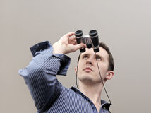 Man with little field-glass. Big man with little field-glass Royalty Free Stock Photo