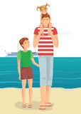 A man with little girl and boy on beach Stock Photography
