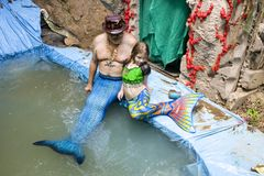 Mer Family - A Man and little girl dressed as merpeople in pool at Renaissance Faire in Muskogee Oklahoma USA 5 28 2017 stock photos