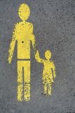 Man and little girl walking sing. On the pavement Stock Images
