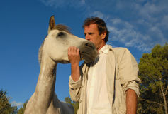 Man and little horse. Man and his best friend little white horse Stock Images