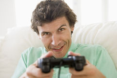 Man in living room playing videogames Stock Image