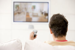 Man in living room watching television Royalty Free Stock Photography