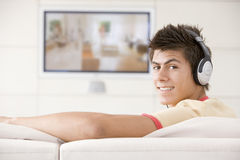 Man in living room watching television royalty free stock image