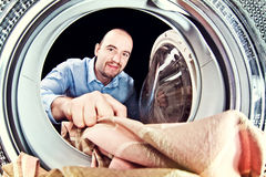 Man Load Washing Machine Royalty Free Stock Photos