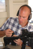 Man loading ammo. Royalty Free Stock Photos