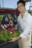Man Loading Flowers into back of Van Royalty Free Stock Image