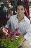 Man Loading Flowers into back of Van. Portrait Royalty Free Stock Photos