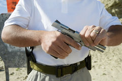 Man Loading Hand Gun At Firing Range Stock Photos