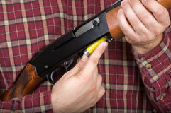 Man loading shotgun Stock Image