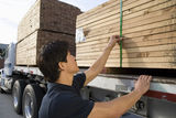 Man Loading Stack Of Plank On Trailer Royalty Free Stock Photo
