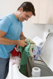 Man Loading Washing Machine Royalty Free Stock Photos