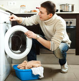 Man loading the washing machine Stock Photography