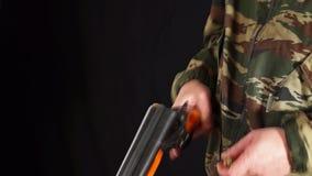 Man loads hunting rifle stock video footage
