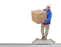 Man loads a package. Man carries a box up the ramp of a truck Royalty Free Stock Images