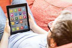Man with locked tablet Stock Images
