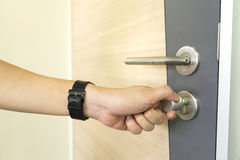Man locking Door Handles stainless steel on door wood.  Stock Photo
