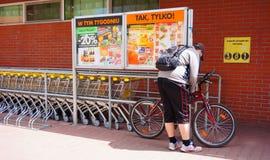 Man locking his bicycle Royalty Free Stock Image