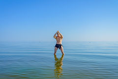 A man in a loincloth standing in water Royalty Free Stock Photos