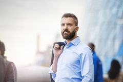 Man in London. Handsome young man in blue shirt in the streets of London Stock Images