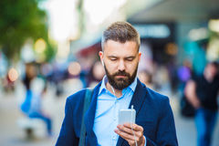 Man in London. Handsome young manager with smartphone in London Stock Photo
