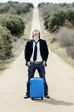 Man in Lonely Road with Suitcase Royalty Free Stock Images