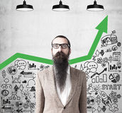 Man with long beard and green graph Royalty Free Stock Photography
