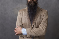 Man with long beard with his arms crossed Stock Photo