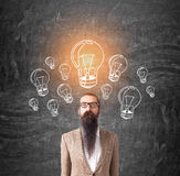 Man with long beard and many bulbs Stock Image