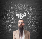 Man with long beard and MBA sketch, blackboard Royalty Free Stock Photography