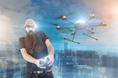 Man with long beard playing a game in vr royalty free stock images