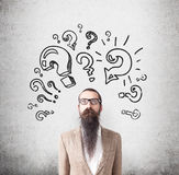 Man with long beard and question marks Stock Photo