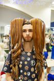 Man with long hair. Cosplay character. Gomel, Belarus - March 24, 2018: International festival of hairdressers. Man with long hair. Cosplay character Stock Images