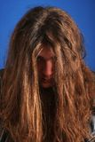Man with long hair frustrated Stock Images