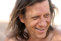 A man with long hair smiling royalty free stock photos