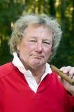 man long hair smoking large cigar Royalty Free Stock Photo